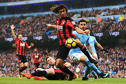 Nathan Ake of Bournemouth clears under pressue from Kyle Walker of Manchester City - Mandatory by-line: Matt McNulty/JMP - 23/12/2017 - FOOTBALL - Etihad Stadium - Manchester, England - Manchester City v Bournemouth - Premier League