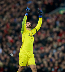 LIVERPOOL, ENGLAND - Saturday, December 29, 2018: Liverpool's goalkeeper Alisson Becker celebrates his side's third goal during the FA Premier League match between Liverpool FC and Arsenal FC at Anfield. Liverpool won 5-1. (Pic by David Rawcliffe/Propaganda)