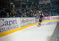 KELOWNA, CANADA - OCTOBER 18:  Tyrell Goulbourne #12 of the Kelowna Rockets engages fans as he skates behind the net on the ice as the Prince George Cougars visit the Kelowna Rockets on October 18, 2012 at Prospera Place in Kelowna, British Columbia, Canada (Photo by Marissa Baecker/Shoot the Breeze) *** Local Caption ***