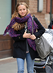 (UK RIGHTS ONLY) Actor Toby Maguire's wife Jennifer Meyer smiling as she leaves her hotel with an oversized scarf and handbag. NYC, USA. 07/02/2013<br />