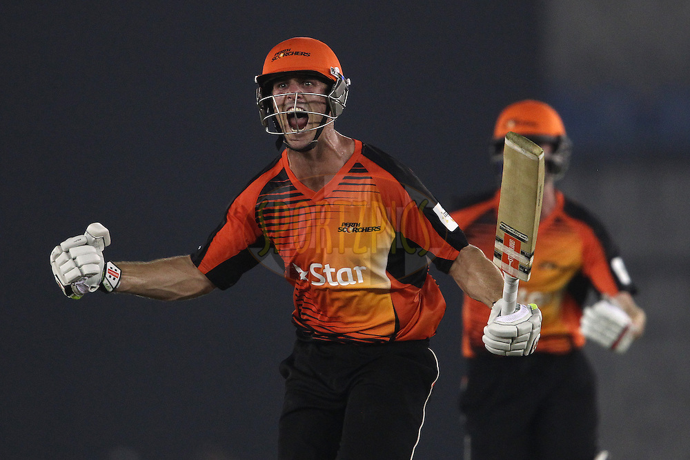 Mitchell Marsh of the Perth Scorchers celebrates after hitting a six off the final ball to beat Dolphins during match 4 of the Oppo Champions League Twenty20 between the Dolphins and the Perth Scorchers held at the Punjab Cricket Association Stadium, Mohali, India on the 20th September 2014<br /> <br /> Photo by:  Shaun Roy / Sportzpics/ CLT20<br /> <br /> <br /> Image use is subject to the terms and conditions as laid out by the BCCI/ CLT20.  The terms and conditions can be downloaded here:<br /> <br /> http://sportzpics.photoshelter.com/gallery/CLT20-Image-Terms-and-Conditions-2014/G0000IfNJn535VPU/C0000QhhKadWcjYs