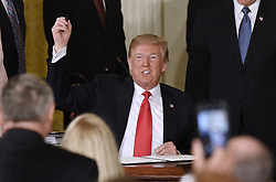 President Donald Trump reacts after signing a National Space Directive to establish Space Traffic Management program to address challenge of congestion of satellites and space vehicles in Earth orbit during a meeting with the National Space Council in the East Room of the White House, in Washington, D.C., on June 18, 2018. Photo by Olivier Douliery/ Abaca Press