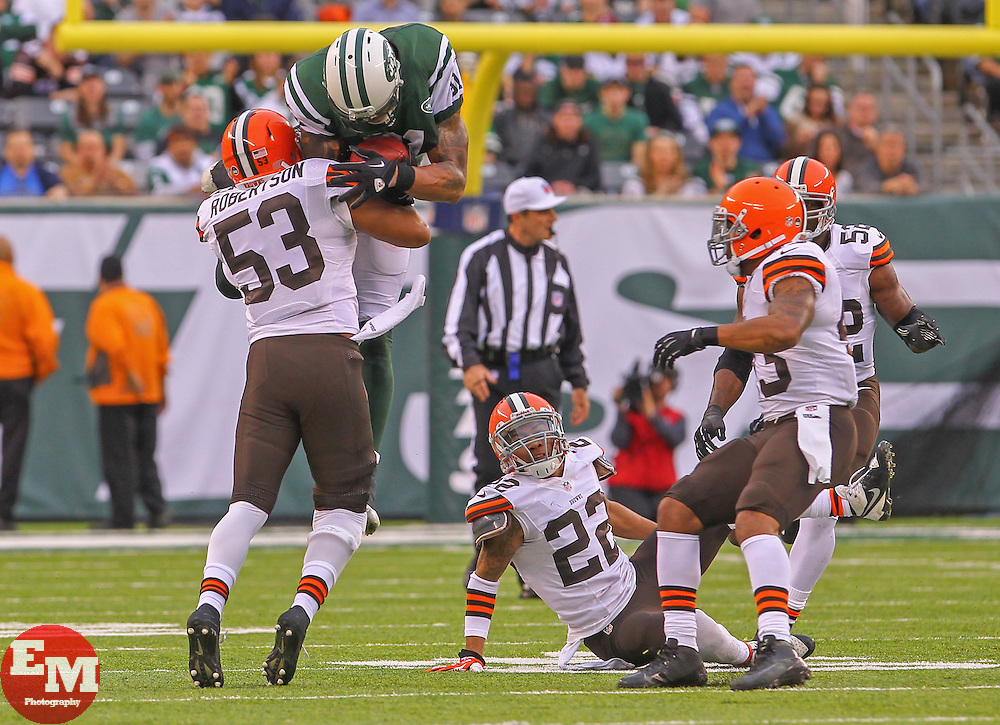 Dec 22, 2013; East Rutherford, NJ, USA; New York Jets tight end Kellen Winslow (81) is hit by Cleveland Browns inside linebacker Craig Robertson (53) during the first half at MetLife Stadium.