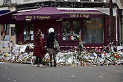 Paris | 03 December 2015<br /> <br /> On the evening of 13 November 2015, a series of coordinated terrorist attacks occurred in Paris, the capital of France, and its northern suburb, Saint-Denis. Beginning at 21:20 CET, three suicide bombers struck near the Stade de France in Saint-Denis, followed by suicide bombings and mass shootings at caf&eacute;s, restaurants and the music venue Bataclan in Paris.<br /> The attackers killed 130 people (state of Dec 09, 2015), including 89 at the Bataclan, where they took hostages before engaging in a stand-off with police forces. There were 368 injuries. Seven of the attackers also died.<br /> The attacks were the deadliest on France since World War II and the deadliest in the European Union since the Madrid train bombings in 2004.<br /> Here: Two women are seen standing at a mourning site in front of the italian restaurant &quot;Casa Nostra&quot;, 2 Rue de la Fontaine au Roi, 75011 Paris.<br /> <br /> &copy;peter-juelich.com<br /> <br /> [No Model Release | No Property Release]