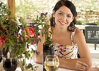 Young Woman at Table outdoors portrait.