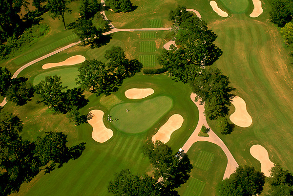 Stock photo of an aerial view of a golf course with multiple sand traps
