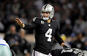 Dec 17, 2017; Oakland, CA, USA; Oakland Raiders quarterback Derek Carr (4) line sup from the line of scrimmage against the Dallas Cowboys during an NFL football game at Oakland-Alameda County Coliseum.