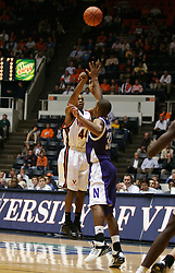 UVA point guard Sean Singletary (44) shoots one of his four three point baskets over a Northwestern defender.  Singletary scores a game leading 23 points as UVA beat the Wildcats 72-57 in the 2005 ACC/BigTen Challenge...The Virginia Cavaliers Men's Basketball team defeated the Northwestern Wildcats 72-57 in the ACC/BigTen Challenge at University Hall in Charlottesville, VA on November 30, 2005..