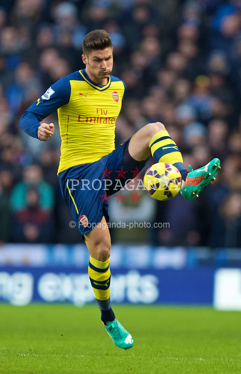 MANCHESTER, ENGLAND - Sunday, January 18, 2015: Arsenal's Oliver Giroud in action against Manchester City during the Premier League match at the City of Manchester Stadium. (Pic by David Rawcliffe/Propaganda)
