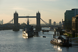 © London News Pictures. 03/04/15. London, UK. Sunrise over Tower Bridge, City of London. Photo credit: Laura Lean/LNP