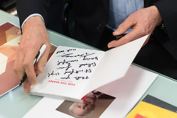 "© Licensed to London News Pictures . 22/03/2018. Manchester, UK. JEREMY CORBYN signs a copy of the Labour Party manifesto with what appears to read "" Thank you Stretford High School for being wonderful "" during a visit to a class at the school in Trafford , after launching of the Labour Party's local election campaign . Photo credit: Joel Goodman/LNP"