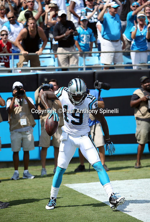 Carolina Panthers wide receiver Ted Ginn, Jr. (19) spins the ball in celebration after catching a 25 yard pass for a touchdown and a second quarter 7-3 lead during the 2015 NFL week 2 regular season football game against the Houston Texans on Sunday, Sept. 20, 2015 in Charlotte, N.C. The Panthers won the game 24-17. (©Paul Anthony Spinelli)
