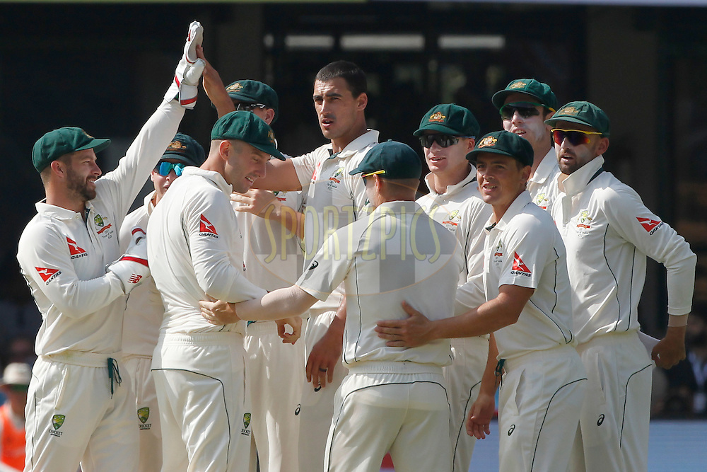 Mitchell Starc of Australia celebrates the wicket of Abhinav Mukund of India during day one of the second test match between India and Australia held at the M Chinnaswamy Stadium in Bangalore on the 4th March 2017. <br /> <br /> Photo by: Deepak Malik / BCCI/ SPORTZPICS