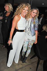 Left to right, KELLY HOPPEN and Dutch singer ESMEE DENTERS at a party to celebrate the Kelly Hoppen and Smallbone kitchen range held at The Collection, 264 Brompton Road, London on 24th September 2012.