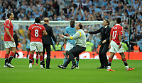 Mario Balotelli and Manchester United's Anderson argue after the final whistle as Roberto Mancini Manager rushes onto the pitch to sepearate the players<br />Manchester City 2010/11<br />Manchester City V Manchester United (1-0) 16/04/11<br />The FA Cup Semi Final at Wembley Stadium<br />Photo: Robin Parker Fotosports International