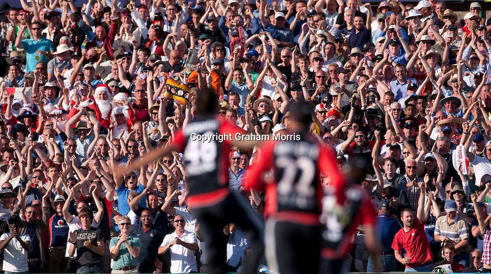 The crowd cheer as Jade Dernbach celebrates bowling Lasith Malinga to win the fifth and final one day international (and the series) between England and Sri Lanka at Old Trafford, Manchester. Photo: Graham Morris (Tel: +44(0)20 8969 4192 Email: sales@cricketpix.com) 06/07/11