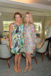Left to right, AMBER NUTTALL and PIPPA VOSPER at a breakfast hosted by Halcyon Days at Fortnum & Mason, 181 Piccadilly, London on 8th July 2014.