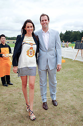 GREG & LUCY RUSEDSKI at the Veuve Clicquot Gold Cup polo final held at Cowdray Park, Midhurst, West Sussex on 18th July 2010.