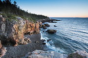 Acadia National Park, Maine.  <br /> It is sunset, and I stand high above the Atlantic on a pedestal of pink granite.  The platform is just about big enough for me and my gear, and the thoughts that I lay out and examine as I wait for the glow.  After awhile on the rock, the motion of the waves and proximity of the edge makes me feel like I'm floating.  The ocean has blasted this coast forever, and the debris of former cliffs litter this little bay. The cove below me dead ends a ways behind me, against a wall of rock, that forms a bridge of sorts, that I crossed from the cliffs to get out here. I have often climbed down the ledges and slabs of Acadia to explore a beach or cove, but the cliffs here are too sheer, and I do not see a clear way down. Sometimes it&rsquo;s better to look at things from a different perspective--to view as if from a raven's nest.  I know what it's like at ground level.  If I walk that beach, the walls will shelter me from the wind.  I will move on rounded stones of exquisite smoothness.  The tide will rise and recede ahead, each wave a demarcation of time.  Washing in one after another, they talk to you like a welcoming conversation. Going forward is going to the edge.  I could go back, but do I want to?  I&rsquo;m lost in it, kind of hypnotized, living the dream.  But I am two people.  The other tries to see what's ahead for himself down there, and wonders if there's a direction that's safe for his journey.  That part of me sees walls that narrow my vision, watches me struggle on bad footing, hears the lies in the waves, waiting to betray me.  Rational versus emotional.  One lives in the moment, the other wants to avoid the unavoidable.  Both find no answers in the end, do they...and I ask myself, which has the better view?