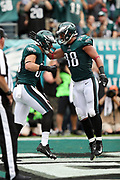 Philadelphia Eagles tight end Zach Ertz (86) celebrates with Philadelphia Eagles tight end Trey Burton (88) after Ertz scores on an 11 yard touchdown run good for a 14-0 first quarter Eagles lead during the 2017 NFL week 5 regular season football game against the against the Arizona Cardinals, Sunday, Oct. 8, 2017 in Philadelphia. The Eagles won the game 34-7. (©Paul Anthony Spinelli)