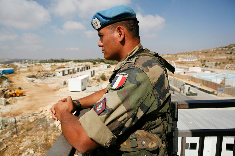 "Originally created in 1978, The United Nations Interim Force in Lebanon (UNIFIL) was created to ensure oversee an Israeli withdrawal from Lebanon, who at that time began its occupation of southern Lebanon that lasted until 2000. After the Israeli war on Lebanon in 2006, UNIFIL enhanced its presence in southern Lebanon to monitor the cessation of hostilities. ..Pictured: A French soldier stands in a tower looking over the hills of southern Lebanon at the UNIFIL French camp ""2.45"" in al-Tiri in southern Lebanon."
