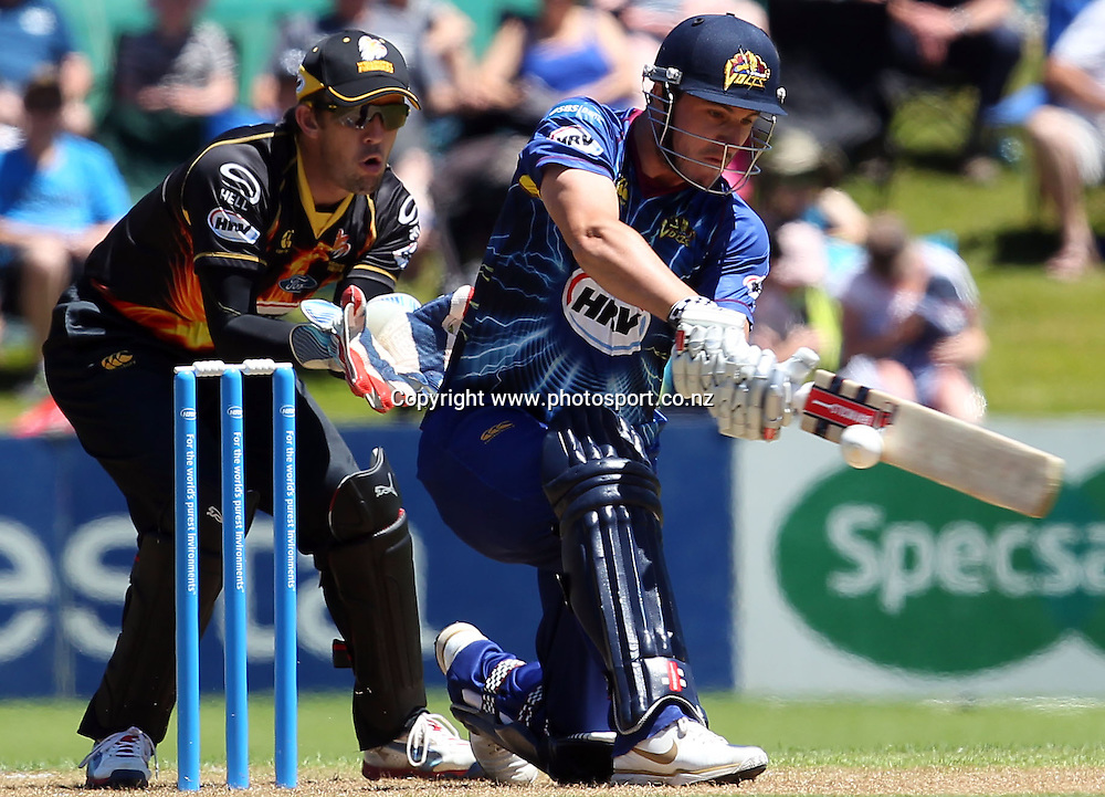 Hamish Rutherford hits out for the Otago Volts.<br /> Twenty20 Cricket - HRV Cup, SBS Bank Otago Volts v Hell Wellington Firebirds, 23 December 2012, University Oval, Dunedin, New Zealand.<br /> Photo: Rob Jefferies / photosport.co.nz
