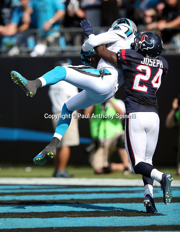 Carolina Panthers wide receiver Corey Brown (10) jumps and catches a 36 yard pass for a fourth quarter touchdown and a 24-10 lead while covered by Houston Texans cornerback Johnathan Joseph (24) during the 2015 NFL week 2 regular season football game against the Houston Texans on Sunday, Sept. 20, 2015 in Charlotte, N.C. The Panthers won the game 24-17. (©Paul Anthony Spinelli)