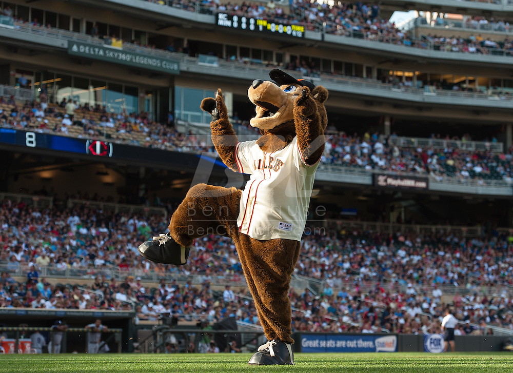 Wearing the 1951 uniform of the Minneapolis Millers,  Minnesota Twins mascot TC takes action during the announcement of the starting lineup before a game against the Kansas City Royals at Target Field on June 30, 2012 in Minneapolis, Minnesota.  This was the second game of a split double header.  The Twins defeated the Royals 5 to 1. © 2012 Ben Krause