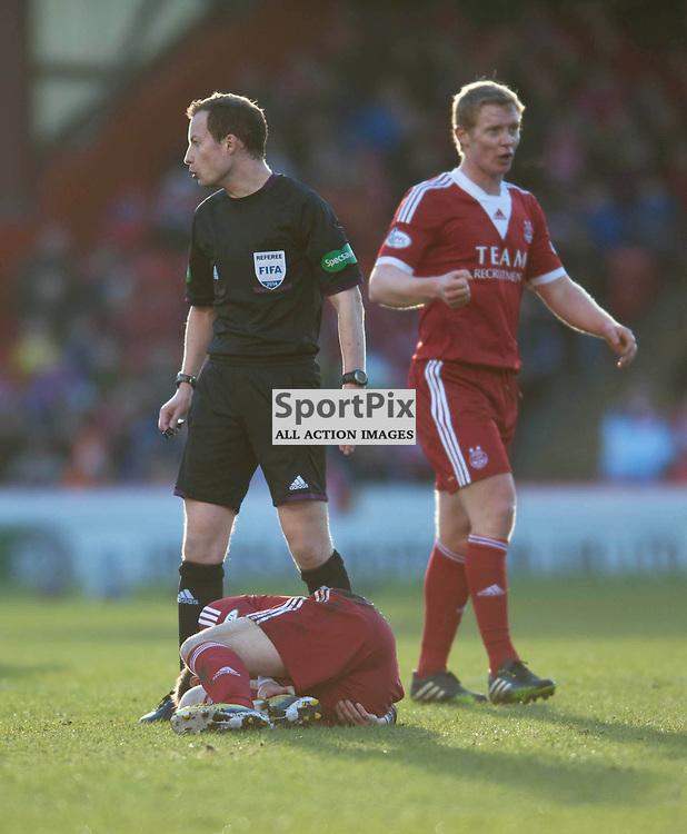 Peter Pawlett lies injured as Referee William Collum looks on. Aberdeen v St Johnstone, Scottish Premiership, Pittodrie Stadium, Saturday 01 March 2014 (c) ANGIE ISAC | SportPix.eu
