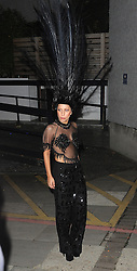 Lady GaGa wearing a feathered headpiece, sheer top and black trousers leaving the ITV studios in London, after appearing on The Graham Norton Show. UK. 29/10/2013<br />BYLINE MUST READ : GOTCHAIMAGES.COM<br /><br />Copyright by © Gotcha Images Ltd. All rights reserved.<br />Usage of this image is conditional upon the acceptance <br />of Gotcha Images Ltd, terms and conditions available at<br />www.gotchaimages.com