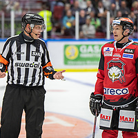 2019-09-17 | Malmö, Sweden: Malmö Redhawks (50) Tobias Ekberg discussing with the referee during the game between Malmö Redhawks and Rögle BK at Malmö Arena ( Photo by: Roger Linde | Swe Press Photo )<br /> <br /> Keywords: Malmö Arena, Malmö, Icehockey, SHL, Malmö Redhawks, Rögle BK, mr190917