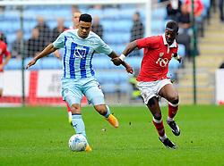 Bristol City's Kieran Agard battles for the ball with Coventry City's Jordan Willis  - Photo mandatory by-line: Joe Meredith/JMP - Mobile: 07966 386802 - 18/10/2014 - SPORT - Football - Coventry - Ricoh Arena - Bristol City v Coventry City - Sky Bet League One