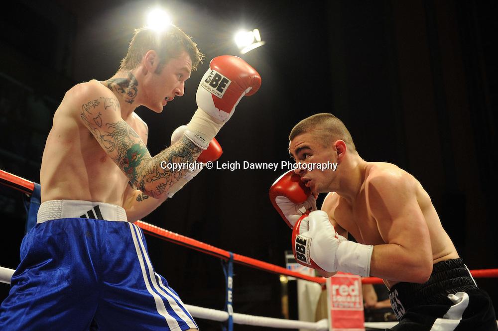Joe Hughes (black shorts) defeats Jason Carr at The Troxy, Limehouse, London, 16th October 2010. Frank Maloney Promotions © Photo credit: Leigh Dawney