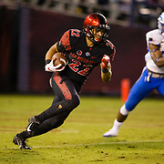 12 October 2018: San Diego State Aztecs running back Chase Jasmin (22) reverse's direction to get out of his end zone on a rushing play late in the fourth quarter trailing 17-14. The Aztecs beat the Falcons 21-17 Friday night at SDCCU Stadium.