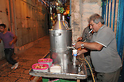 Israel, Jerusalem serving Salep at a stall in the market .