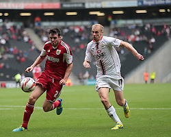 Bristol City's Brendan Moloney and Milton Keynes Dons' Luke Chadwick challenge for the ball  - Photo mandatory by-line: Nigel Pitts-Drake/JMP - Tel: Mobile: 07966 386802 24/08/2013 - SPORT - FOOTBALL - Stadium MK - Milton Keynes - Milton Keynes Dons V Bristol City - Sky Bet League One