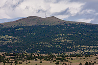 The east side of 8,720 ft. Sierra Grande, a large shield volcano on the plains of northeastern New Mexico.