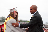 Valedictorian Tyler Smith (left) receives his diploma from Principal Courtney Blake during the Northridge High School 79th annual commencement at the Northridge High School Stadium in Dayton, Friday, June 1, 2012.