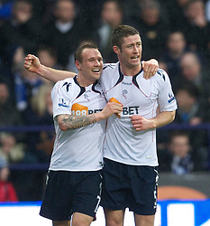 BOLTON, ENGLAND - Sunday, February 13, 2011: Bolton Wanderers' Gary Cahill celebrates scoring the opening goal against Everton with team-mate Matthew Taylor (L) during the Premiership match at the Reebok Stadium. (Photo by David Rawcliffe/Propaganda)