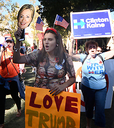 October 19, 2016 - Las Vegas, Nevada, U.S. - Clinton and Trump supporters rally together at UNLV hours before the debate Wednesday. Today will be the 3rd and final presidential debate between Republican presidential nominee Donald Trump and Democratic presidential nominee Hillary Clinton at Las Vegas Nevada University. (Credit Image: © Gene Blevins via ZUMA Wire)