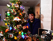 apl120716g/ASECTION/pierre-louis/JOURNAL/120716<br /> P.J. Sedillo,,  is seen in his Los Ranchos home with the Christmas tree he designed as a tribute to the victims of the Orlando nightclub mass shootings.   .Photographed  on Wednesday December 78, 2016. .Adolphe Pierre-Louis/JOURNAL