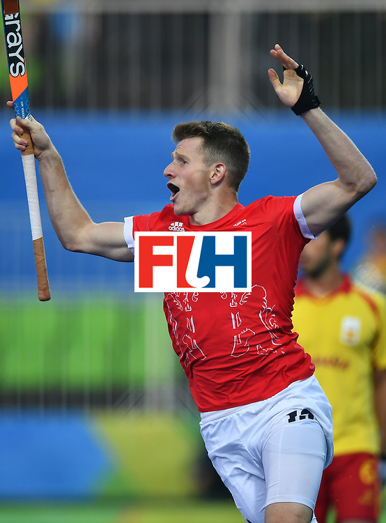 Great Britain's Sam Ward celebrates scoring a goal during the mens's field hockey Britain vs Spain match of the Rio 2016 Olympics Games at the Olympic Hockey Centre in Rio de Janeiro on August, 12 2016. / AFP / MANAN VATSYAYANA        (Photo credit should read MANAN VATSYAYANA/AFP/Getty Images)
