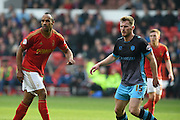 Nottingham Forest striker Chris O'Grady  and Sheffield Wednesday defender Tom Lees during the Sky Bet Championship match between Nottingham Forest and Sheffield Wednesday at the City Ground, Nottingham, England on 12 March 2016. Photo by Jon Hobley.