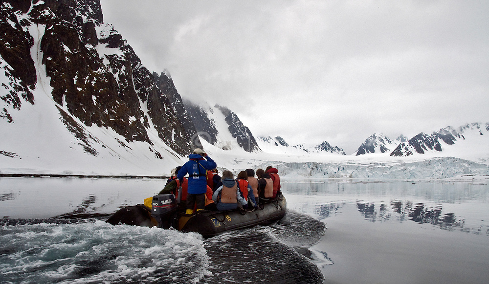 "Tourists from the vessle ""Polar Star"" exploring glaciers in Raudfjorden, norwthern Spitsbergen (Svalbard)."