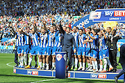 Wigan lift the League 1 trophy after lead by there Manager Gary Caldwell after the Sky Bet League 1 match between Wigan Athletic and Barnsley at the DW Stadium, Wigan, England on 8 May 2016. Photo by John Marfleet.