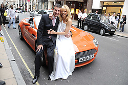 Australian award winning jewellery designer John Calleija and special guest Claudia Schiffer hosted the launch party of Calleija's new London store in the Royal Arcade, Old Bond Street, London on 24th June 2008.<br /><br />Picture shows:- John Calleija and his wife Noni beside an Aston Martin.