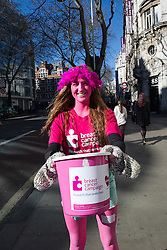 A volunteer helping to collect funds for breast cancer research on the streets of london