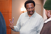 18516Appalachian Scholars Open House reception 12/10/07..Sylvester James Aji talks to Nate Johnson from Logan, OH......Appalachian Scholars program: A Q&A.Information session scheduled tonight.Dec. 10, 2007.By George Mauzy..The Athens campus will host its third annual Appalachian Scholars information session for high school students and parents at 7 p.m. today in the Baker University Center Ballroom. Organizers will outline the program's requirements and answer questions...In anticipation of tonight's event, Outlook asked Associate Provost for Appalachian Access and Enrichment Programs Richard Greenlee to share his thoughts about the program. But first, some background...The Appalachian Scholars award, now in its second year, is a need-based, renewable four-year scholarship award valued at $10,000 each year. It includes an annual book stipend and participation in a yearly leadership seminar...The university has 20 Appalachian Scholars on five campuses, including 12 on the Athens campus and two on each regional campus except Lancaster, which is not in one of Ohio's 29 Appalachian counties. This fall's class of 10 recipients was chosen from more than 150 applicants...Last year's Appalachian Scholars information session, the first large-scale public event held in the new University Center, attracted more than 200 people. A similar crowd is expected tonight...The Eastern campus will host its info session at 6 p.m. Wednesday in Shannon Hall. The Chillicothe and Southern campuses have already held their sessions, and one is expected to be scheduled on the Zanesville campus in January...Why is the Appalachian Scholars program important?..It demonstrates the university's commitment to families and communities in the 29-county region by helping high school students attain a college education...The program teaches students and their families how to navigate the educational experience. It promotes economical sustainability and social mobility by providing the students with an