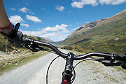 A riders eye view as a mountain biker rides the trail from Walter Peak to Mavora lakes.
