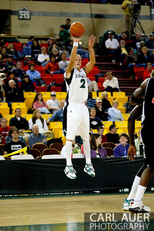 11/25/2006 - Anchorage, Alaska: Junior guard Matt Gibson (2) of the Hawaii Warriors takes a jumper as Hawaii beat Pacific 71-60 to give the Warriors a third place finish in the 2006 Great Alaska Shootout<br />